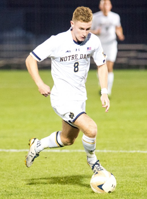 Irish senior Jon Gallagher dribbles upfield during Notre Dame's 1-0 double-overtime victory vs. UConn on Sept. 13.