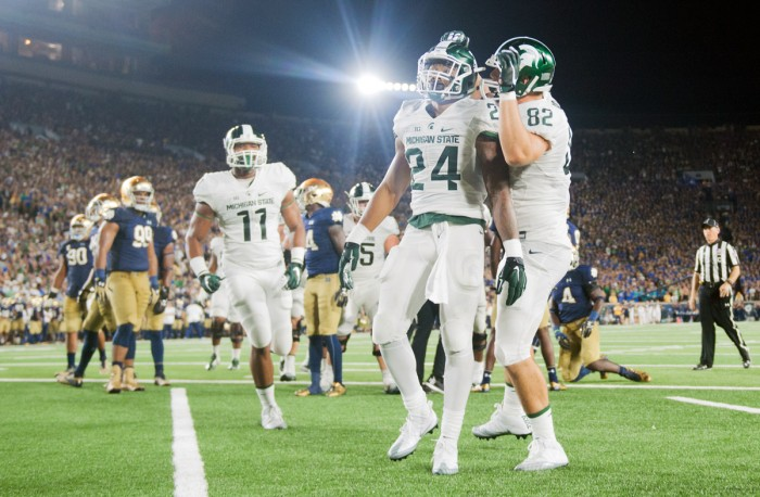 Michigan State players celebrate during Notre Dame's 36-28 loss to the Spartans on Saturday.