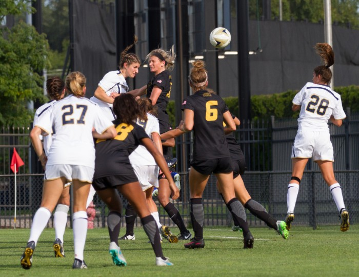 Irish freshman midfielder Alexis Martel-Lamothe, back, heads the ball towards the goal during Notre Dame's 1-0 win over Missouri.