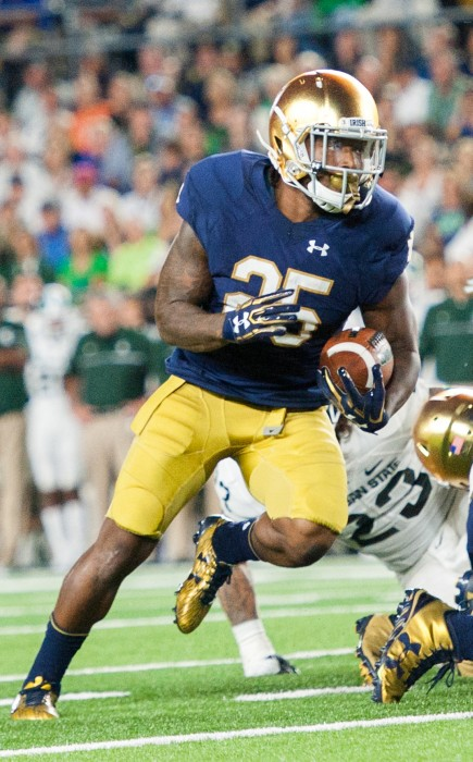 Irish senior Tarean Folston rushes the ball during Notre Dame's 36-28 loss to Michigan State last Saturday at Notre Dame Stadium. Folston touched the ball just four times in the defeat to the Spartans.