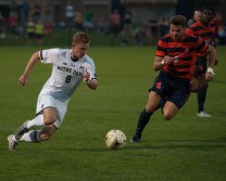 Jon Gallagher sprints down the field at Alumni Field during the Irish's 2-1 win against Syracuse on Friday