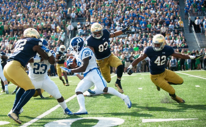 Irish sophomore linebacker Asmar Bilal tangles with a Duke defender in Notre Dame's 38-35 loss to the Blue Devils on Saturday. Kelly said Tuesday that Bilal will see more playing time as the season progresses.