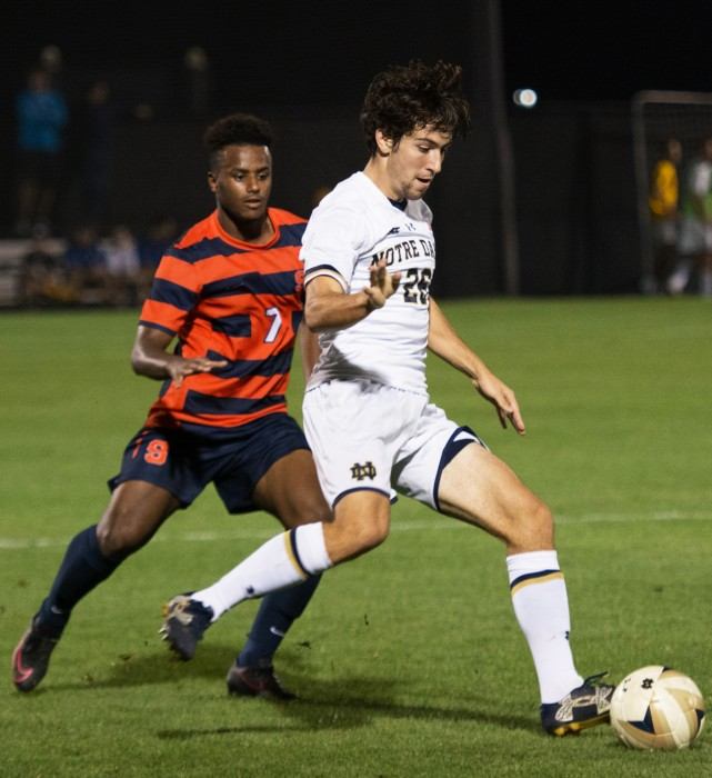 Irish senior midfielder Gormely sets to make a pass in Notre Dame's 2-1 victory over Syracuse on Sept. 23 at Alumni Stadium.