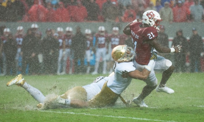 Senior linebacker James Onwualu wraps up the ball carrier during Notre Dame's 10-3 loss to North Carolina State on Saturday.