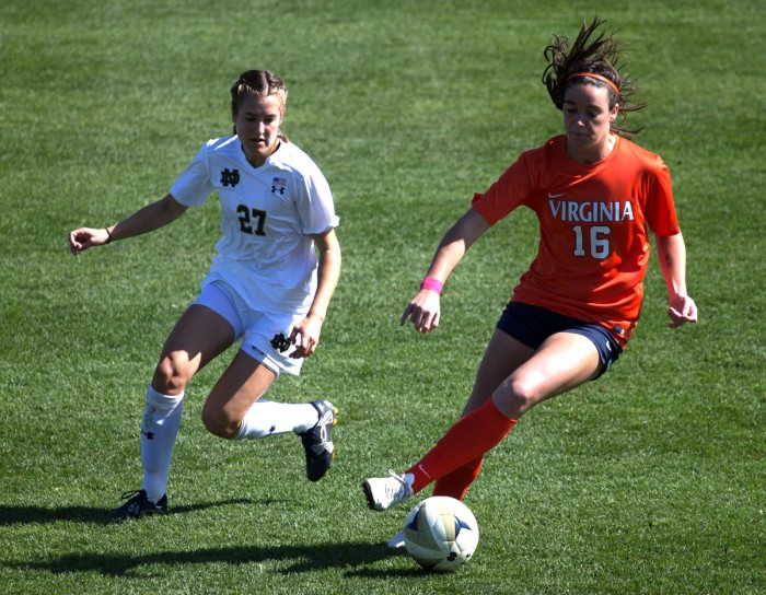Irish senior Kaleigh Olmsted pursues the ball carrier during Notre Dame's 1-0 loss to Virginia on Oct. 9 at Alumni Stadium.