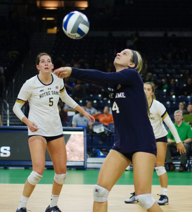 Irish sophomore libero Ryann DeJarld sets the ball during Notre Dame's 3-1 victory over Duke on Sept. 30 at Purcell Pavilion.