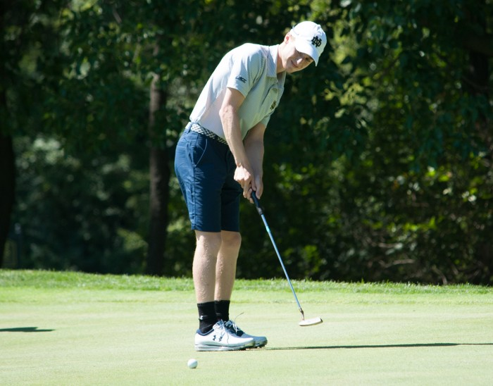 Sophomore Ben Albin watches his putt at the Notre Dame Kickoff Challenge at Warren Golf Course on Sept. 3. Albin won the Georgetown Intercollegiate over fall break with a score of 11-under-par 202.