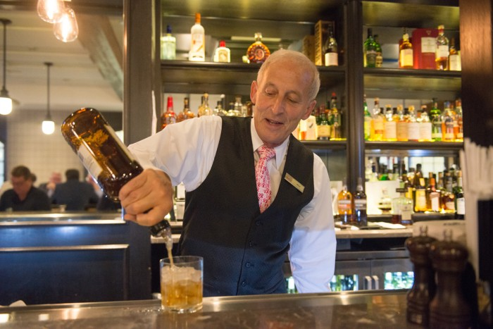 """Patrick """"Murf"""" Murphy tends the bar at Rohr's. He has worked at the Morris Inn since he was 15 years old."""