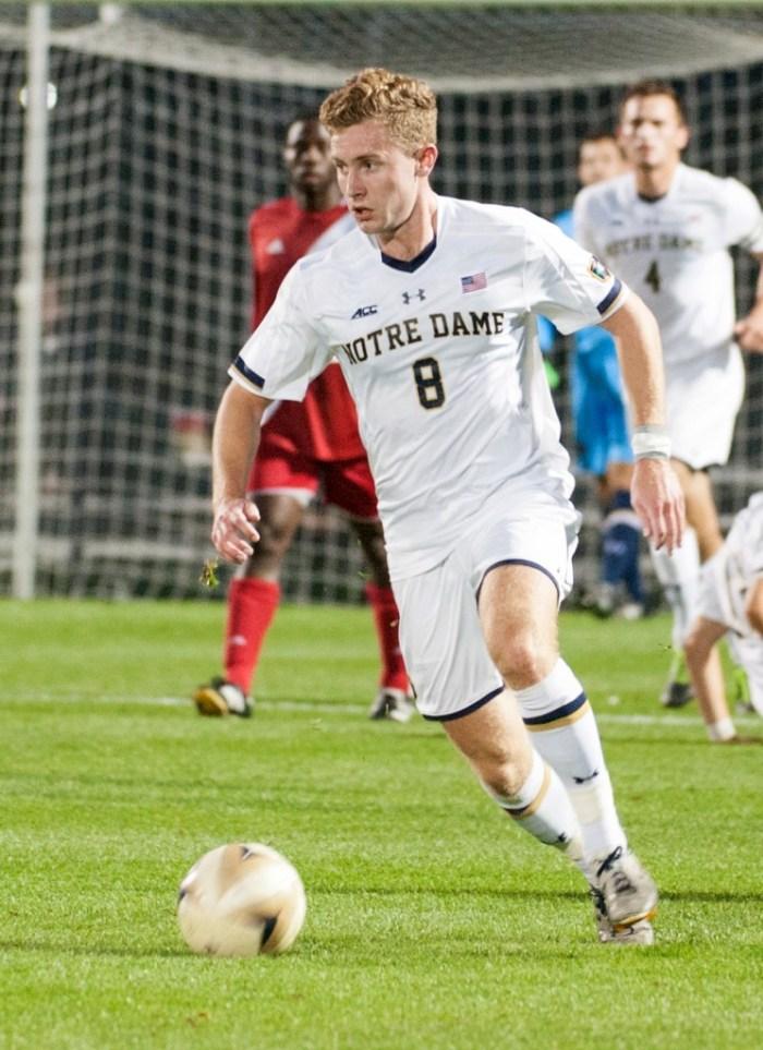 Irish junior forward Jon Gallagher carries the ball upfield during Notre Dame's 4-0 win over Indiana on Oct. 4 at Alumni Stadium.