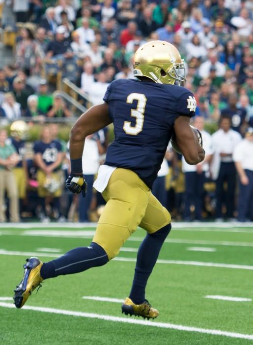Irish sophomore C.J. Sanders returns a kick during Notre Dame's 30-27 win over Miami on Saturday.