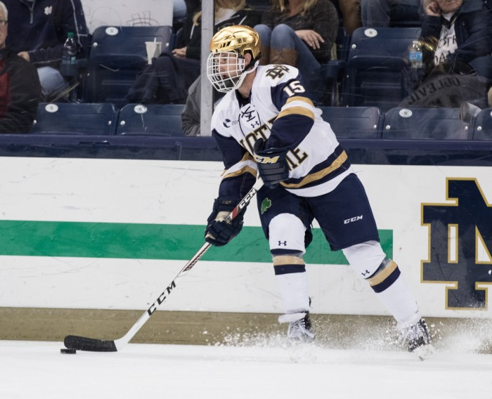 Irish sophomore forward Andrew Oglevie surveys the ice during Notre Dame's 4-2 loss to UConn on Oct. 27 at Compton Family Ice Arena. Oglevie is second on the team in points scored this season with 15.