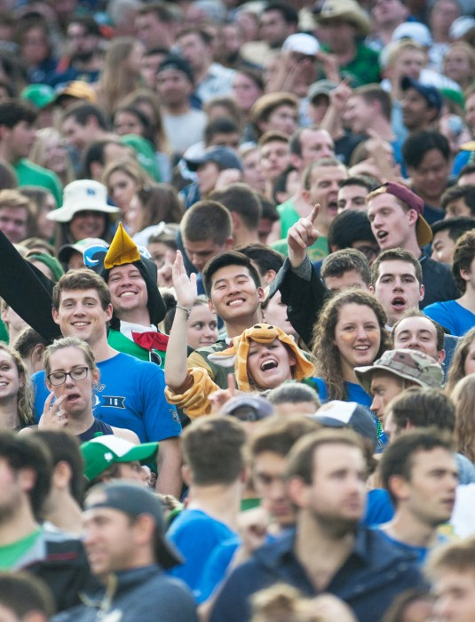 Senior Courtney Davis cheers on the Irish at Saturday's football game against Miami. Fans enjoyed uncharacteristically warm weather in October as Notre Dame beat the Hurricanes 30-27.