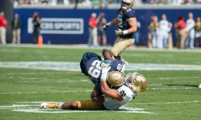 Irish junior Greer Martini tackles the Navy ball carrier behind the line of scrimmage during Notre Dame's 28-27 loss to Navy on Saturday. Martini had 11 total tackles in the game.
