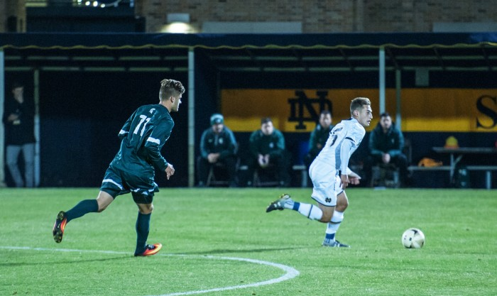 Graduate student midfielder Evan Panken moves the ball upfield during Notre Dame's 1-0 loss to Michigan State on Oct. 25 at Alumni Stadium.