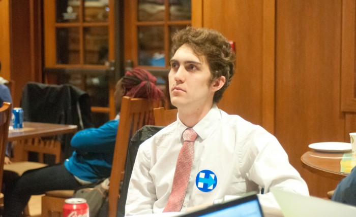 Fifth-year Bryan Ricketts watches the election results stream in at the NDVotes-sponsored event in Geddes Hall.