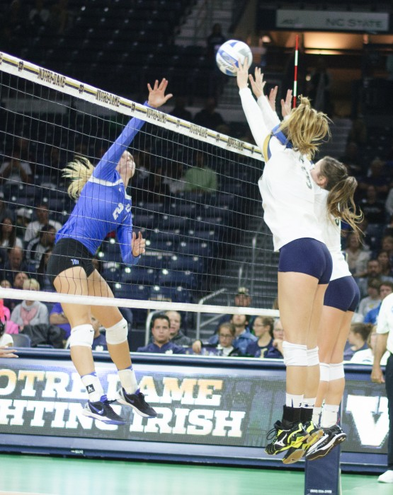 Irish junior middle blocker Sam Fry, left, and sophomore outside hitter Rebecca Nunge go up for a block during Notre Dame's 3-1 win over Duke on Sept. 30 at Purcell Pavilion.