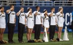 Notre Dame cheerleaders salute during Notre Dame's game versus Army in San Antonio.