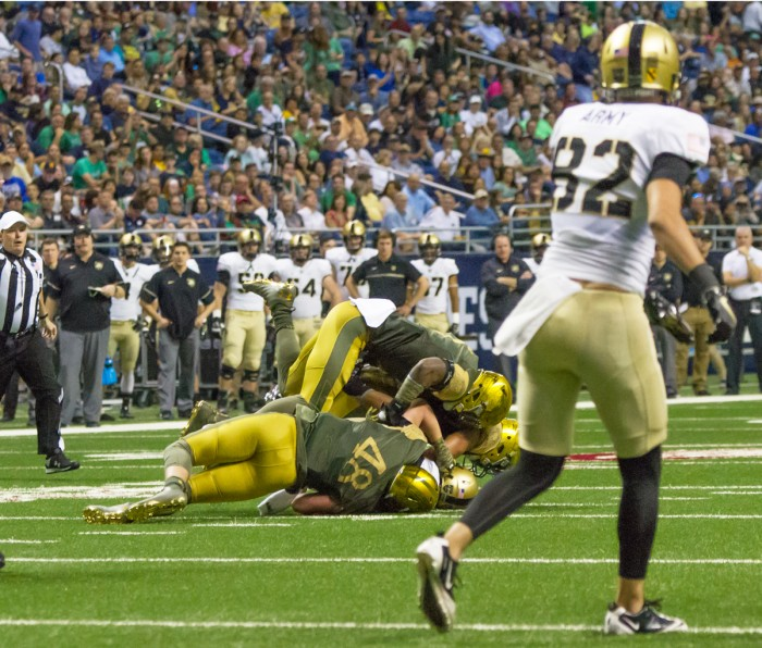 Irish junior linebacker Greer Martini makes a tackle during Notre Dame's 44-6 victory over Army on Saturday in San Antonio.