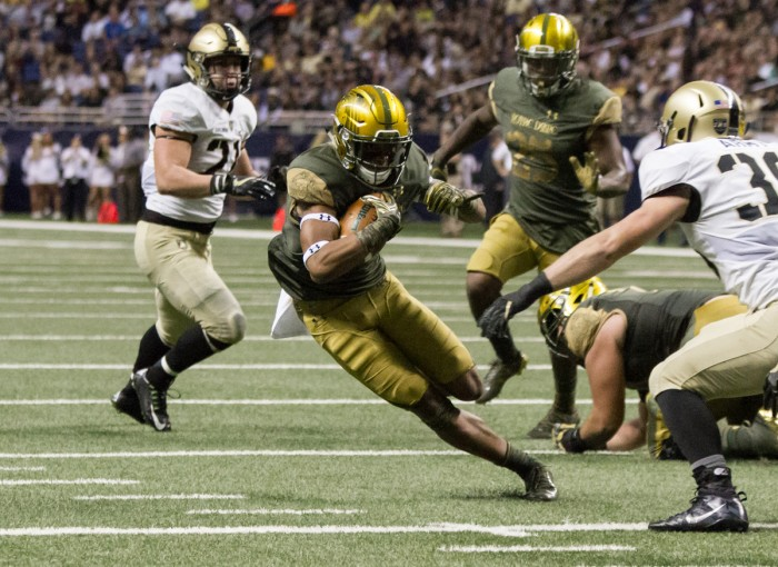 Senior running back Tarean Folston jukes an approaching defender during Notre Dame's 44-6 win over Army on Nov. 12.