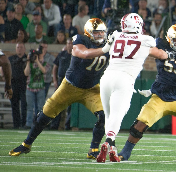 Irish senior offensive lineman Hunter Bivin, left, engages with a Stanford defender during Notre Dame's loss to Stanford at Notre Dame Stadium. Bivin started his first game of the season against the Cardinal.