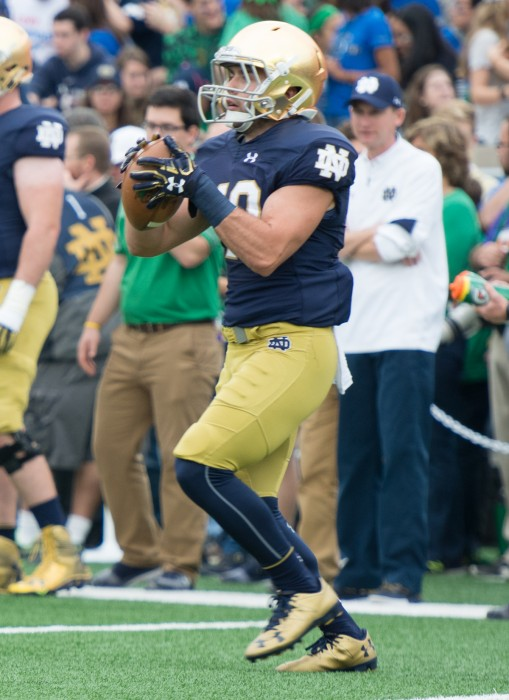 Irish senior running back Bailey Ross warms up before Notre Dame's game against Miami. Ross is a walk-on along with his brother, Austin.