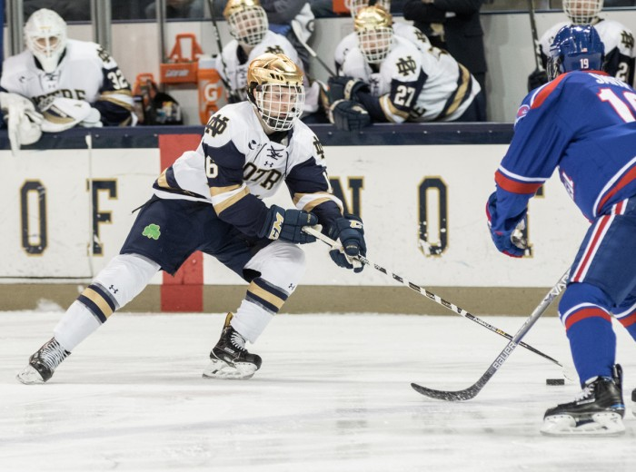 Irish junior forward Connor Hurley hustles up the ice during Notre Dame's 4-1 loss to UMass-Lowell on Nov. 17.