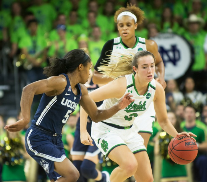 Irish sophomore guard Marina Mabrey attempts to dribble by a UConn defender in Notre Dame's loss to the Huskies on Wednesday at Purcell Pavilion.