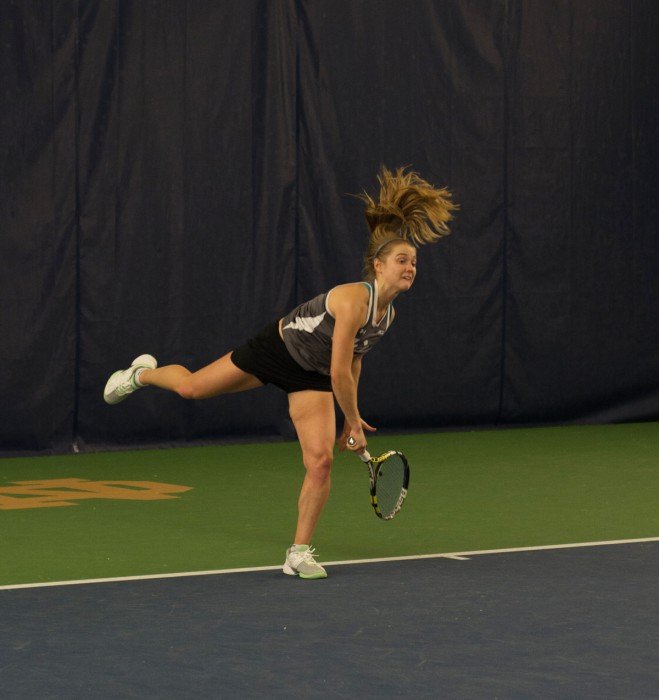 Irish senior Monica Robinson follows through on a serve during Notre Dame's 6-1 victory over Indiana on Feb. 20 at Eck Tennis Pavilion.