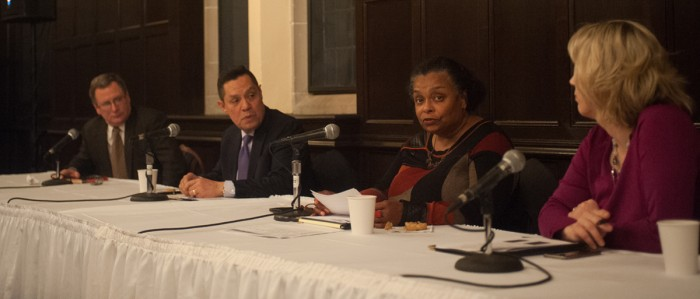 Professors discuss the legacy of Dr. Martin Luther King Jr. in the Oak Room of South Dining Hall Wednesday night as part of Walk the Walk Week. The panelists discussed contemporary racial tensions.