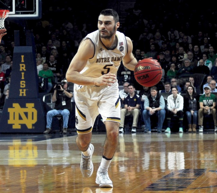 Irish junior guard Matt Farrell advances the ball up the court during Notre Dame's 71-54 loss to Virginia on Tuesday at Purcell Pavilion. Farrell had 15 points and four assists in Notre Dame's loss to Georgia Tech on Sunday.