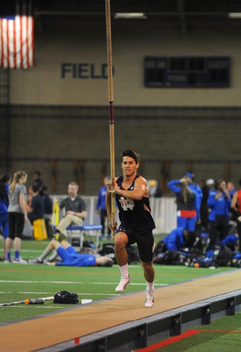 Irish freshman pole vaulter Landon Shank runs toward the bar during the Blue & Gold Invitational on Dec. 2. Shank finished third in the event finals after clearing a 4.70 meter jump.