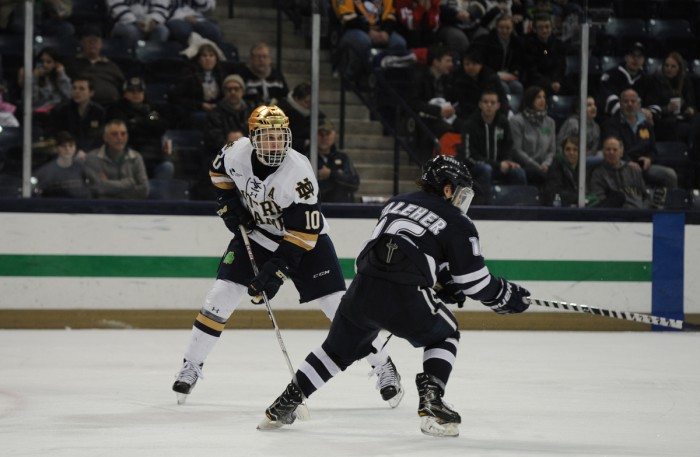 Irish junior forward Anders Bjork surveys the ice during Notre Dame's 2-2 overtime tie with New Hampshire on Jan. 20.