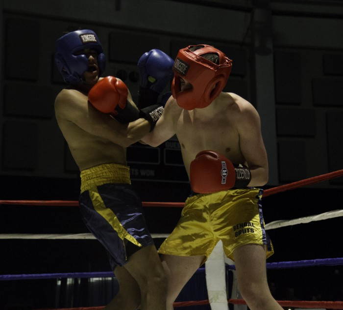 Junior Conor Ward, right, tangles with his opponent, sophomore Alfred Duarte, in the preliminary round of the 146-pound division in the 87th annual Bengal Bouts tournament. Ward went on to win the fight.