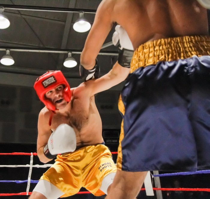"""Senior Jack """"Hammer"""" Corrigan atempts to dodge a punch from freshman Ishaan Goel in a quarterfinal match of the Bengal Bouts tournament Tuesday night at the Joyce Center."""