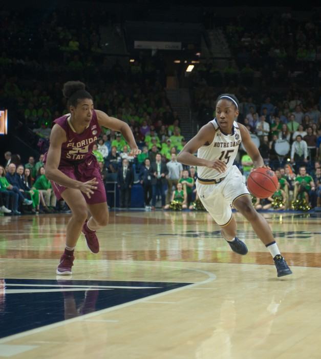 Irish senior guard Lindsay Allen dribbles the ball up court during Notre Dame's 79-61 victory over Florida State on Sunday afternoon at Purcell Pavilion.