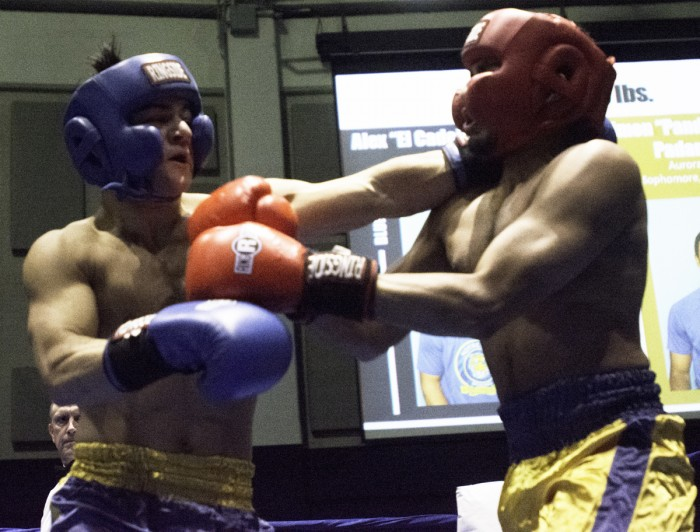 Alumni senior and Bengal Bouts captain Alex Alcantara lands a left jab to his opponent, Keough sophomore Simon Padanilam, during a preliminary round bout Feb. 14 at the Joyce Center Fieldhouse.