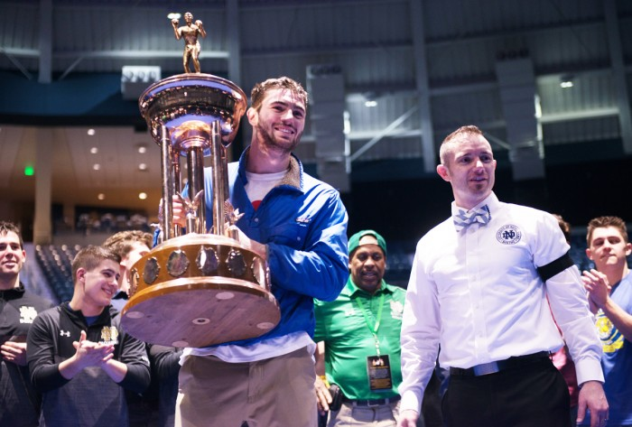 """Senior Jack Considine is awarded a trophy for """"Best Senior Boxer"""" Friday night at Purcell Pavilion. Considine is the president of Bengal Bouts."""
