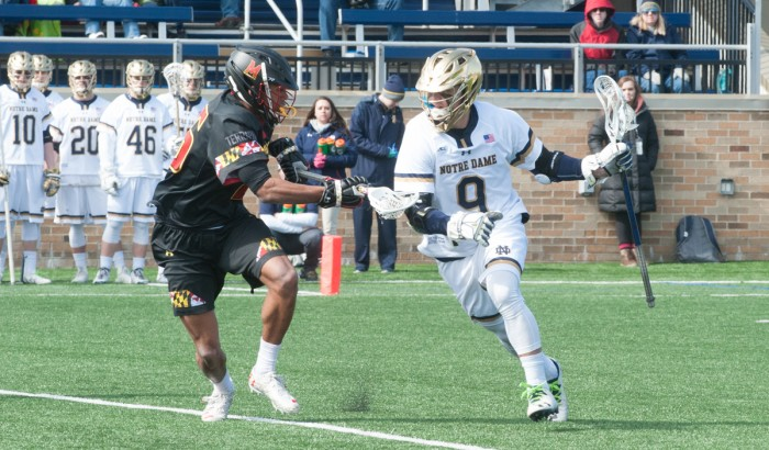 Irish sophomore midfielder Brendan Gleason attempts to get around a defender in Notre Dame's 5-4 win over Maryland on Saturday.