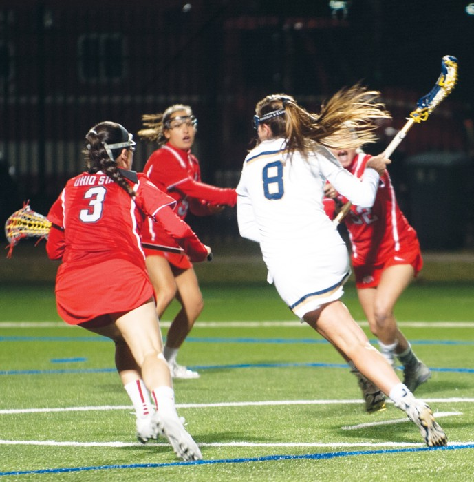 Irish freshman midfielder Savannah Buchanan dodges three Ohio State defenders during Notre Dame's 16-13 win over the Buckeyes on Tuesday at Arlotta Stadium.