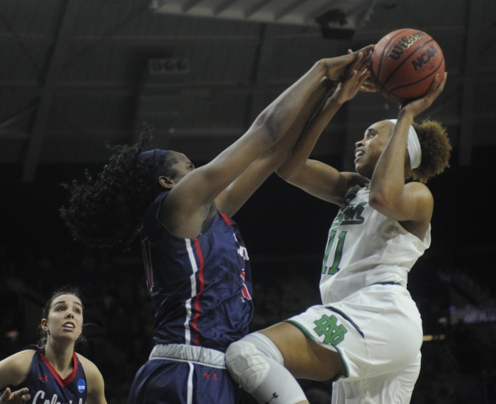 Irish junior forward Brianna Turner fights through contact while attempting a layup during Notre Dame's 79-49 win over Robert Morris on Friday at Purcell Pavilion.