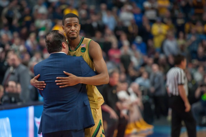 Irish senior forward V.J. Beachem hugs head coach Mike Brey in the final minutes of Notre Dame's 83-71 loss to West Virginia on Saturday at KeyBank Arena.