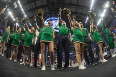 The Notre Dame Cheer Team sing along to the Alma Mater at the end of the team's loss to West Virginia.