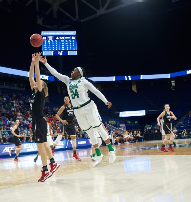 Irish sophomore guard Arike Ogunbowale jumps for the loose ball during Notre Dame's 76-75 loss to Stanford on Sunday at Rupp Arena.