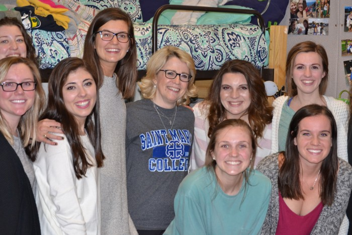 Students pose with Saint Mary's President Jan Cervelli in Le Mans Hall on Thursday night. Cervelli spent the night in a dorm room with three students to gain a better understanding of what residential life is like for students at the College.
