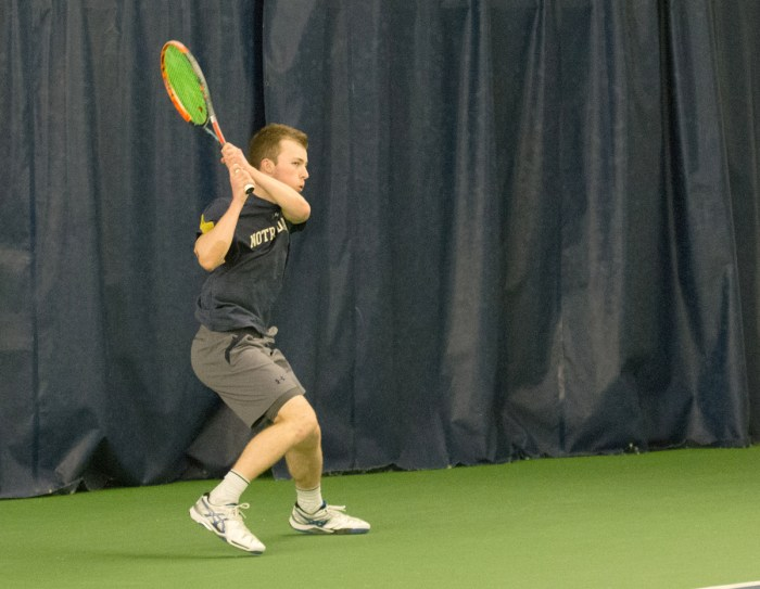 Irish freshman Matt Gamble follows through on a backhand during Notre Dame's 4-1 victory over Northwestern at Eck Tennis Pavilion.