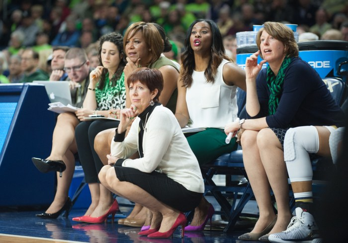 Muffet McGraw squats on the sideline as she watches her team defeat Montana 77-43 to advance to the second round of the NCAA tournament on March 20, 2015 at Purcell Pavilion.