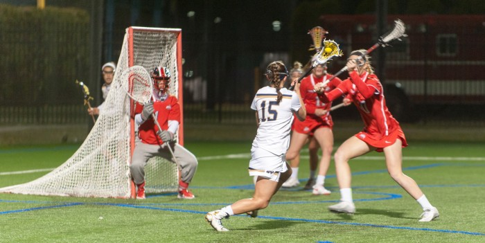 Irish senior attack Cortney Fortunato drives toward the goal during Notre Dame's 16-13 win over Ohio State on March 7 at Arlotta Stadium. Fortunato scored three goals and had one assist during Notre Dame's 13-9 Senior Day win over Virginia Tech on Saturday.