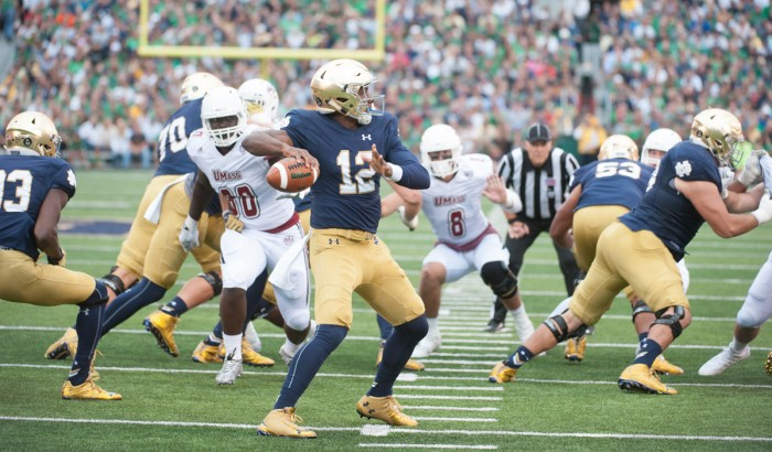 Irish junior quarterback Brandon Wimbush stares down his receiver and steps into a throw during Notre Dame's 62-27 win over UMass on Sept. 26, 2015, at Notre Dame Stadium. Wimbush sat out the 2016 season as a redshirt, but now he stands to start at quarterback for the Irish in 2017 after last year's starter, DeShone Kizer, declared for the NFL Draft.