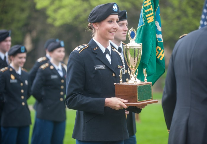 Saint Mary's senior and Army battalion commander Emilie Vanneste accepts an award at the ROTC Pass in Review ceremony Wednesday.