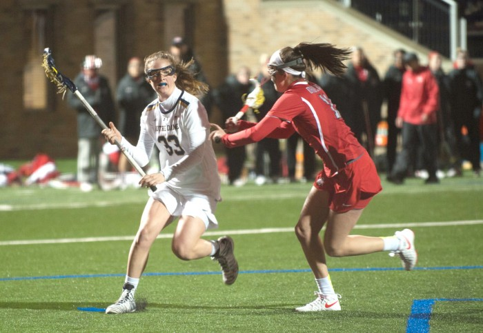 Irish sophomore attack Samantha Lynch dodges a defender during Notre Dame's 16-13 win over Ohio State on March 7 at Arlotta Stadium.